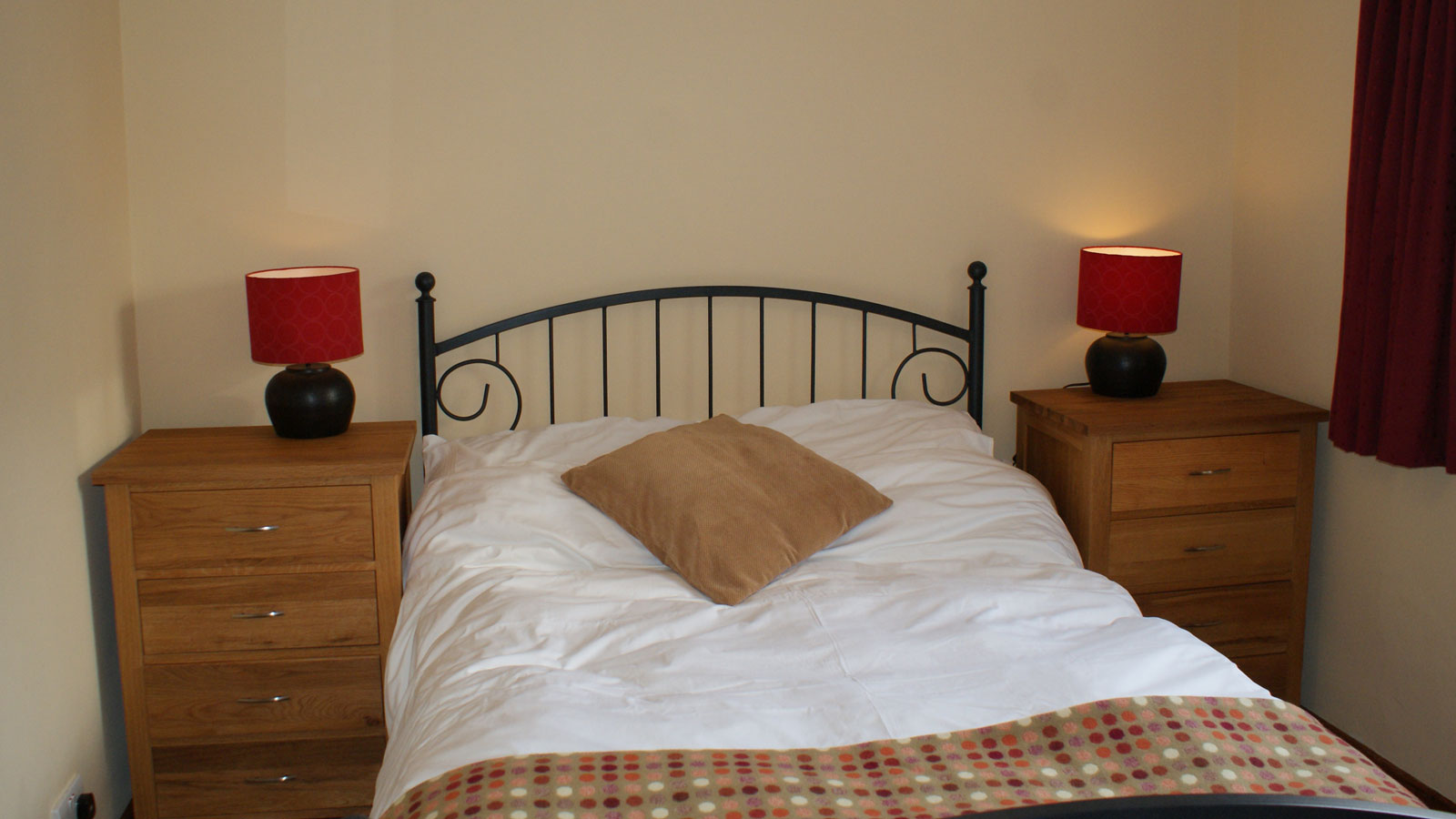 Double bed in Mincorn Holiday Cottage with local Melyn Ty Gwynt throw