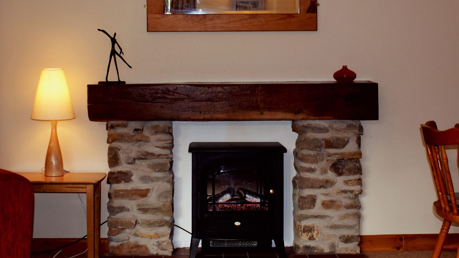 Stone fire place in Mincorn Holiday Cottage